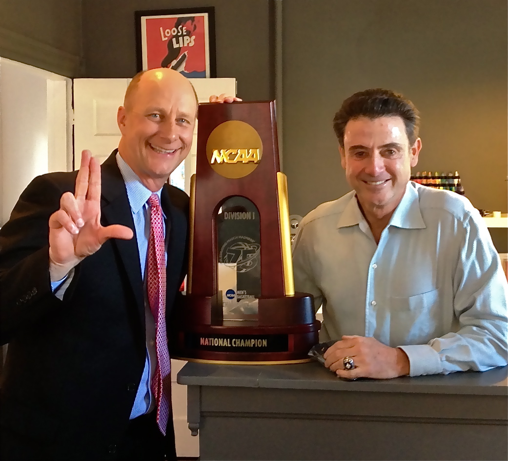 Terry Meiners & Rick Pitino with the NCAA national championship trophy, April 26, 2013.  Pitino had just delivered on a promise to his team that he would get a tattoo if they won the championship.