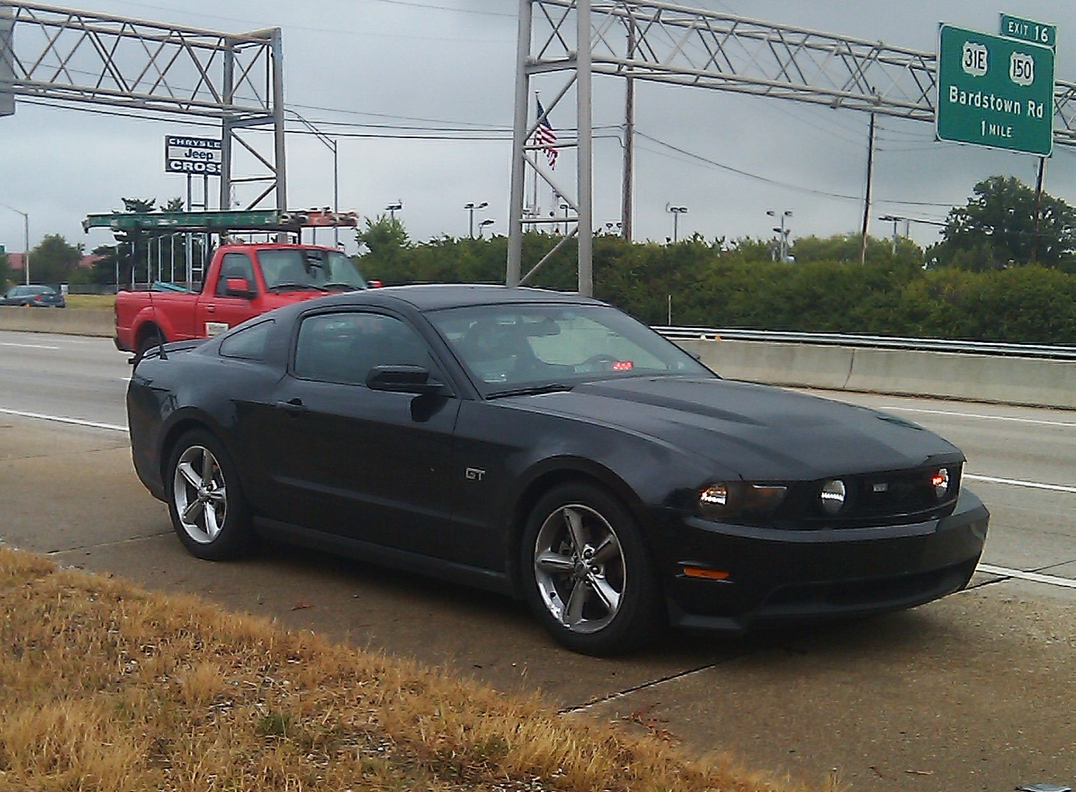 This unmarked black LMPD Mustang was used by former officer Sam Cromity, whose voluminous speeding ticket writing helped him become one of the top earners on the city of Louisville payroll. (photo: September 2011)