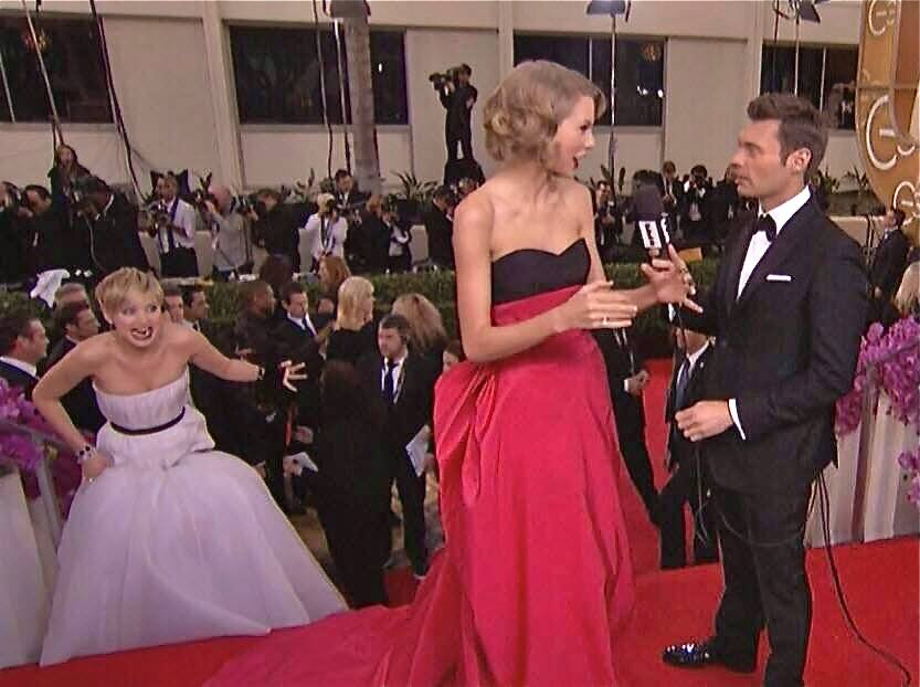Jennifer Lawrence pretends to stalk Taylor Swift while she's being interviewed by Ryan Seacrest.