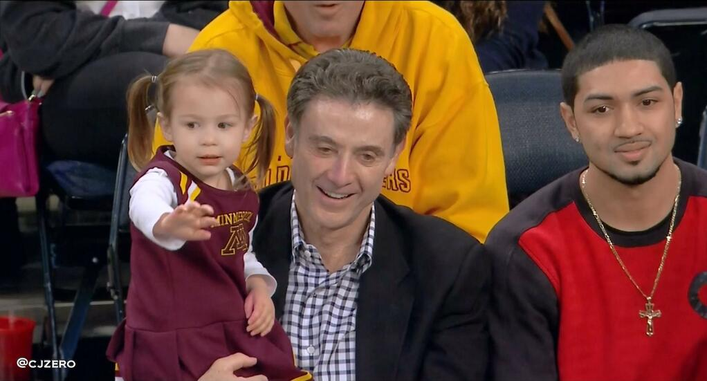 Rick Pitino (with granddaughter) and Peyton Siva at Madison Square Garden, April 3, 2014, watching Richard Pitino's Minnesota team win the N.I.T.