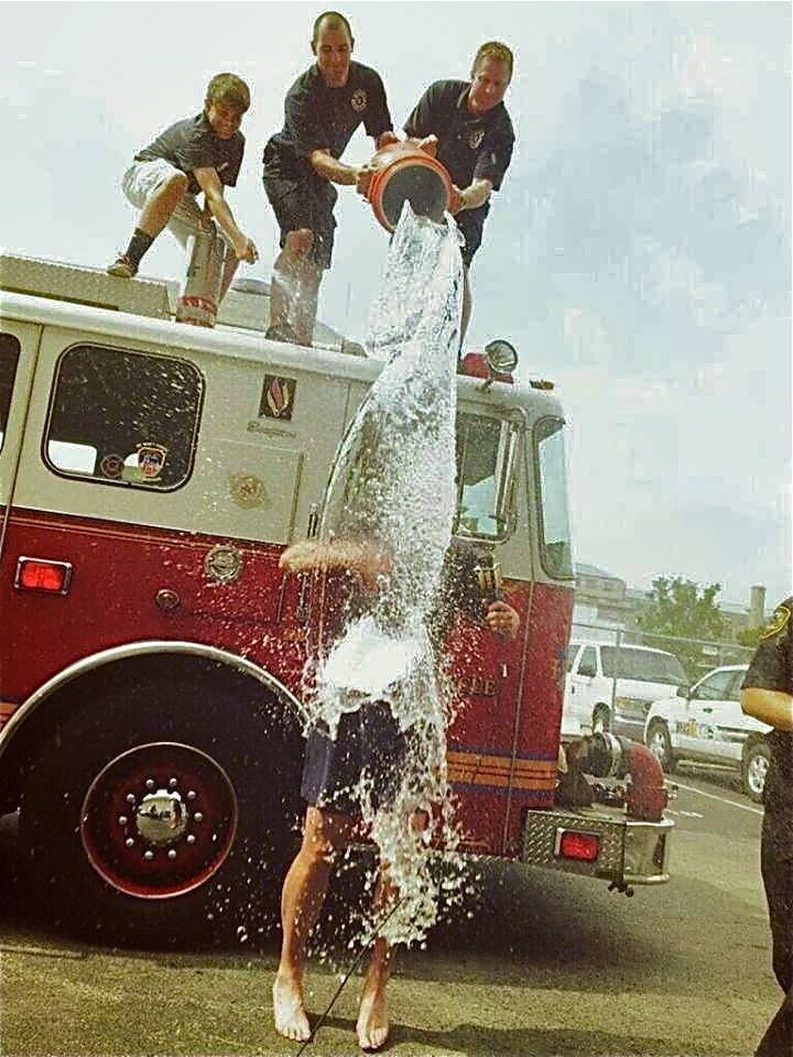 Terry Meiners is doused by Louisville firefighters in another  fundraising Cold Water Challenge prior to the 2014 WHAS Crusade for Children.