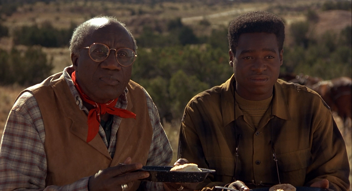 Bill Henderson and Phill Lewis as Ben Jessup and Steve Jessup, father and son dentists in the film City Slickers (1991)