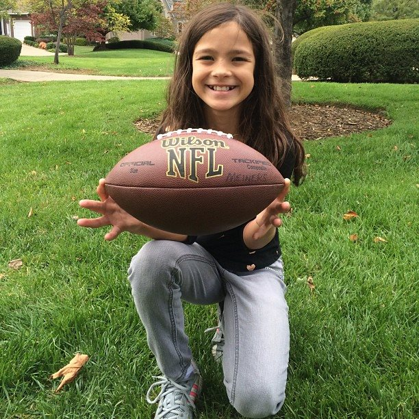 9-year-old Gracie caught her first 40 yard pass on October 5, 2014.  After 4 passes bounced off of her arms, she refused to walk away until she caught one, surpassing last year's 39 yard grab.