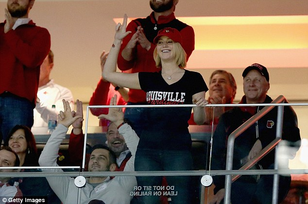 Jennifer Lawrence throws up the Louisville Cardinals L sign at the KFC Yum Center, December 27, 2014