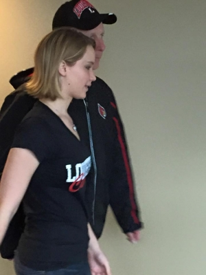 Jennifer Lawrence strolled through a few hallways of the KFC Yum Center to visit friends in various suites.