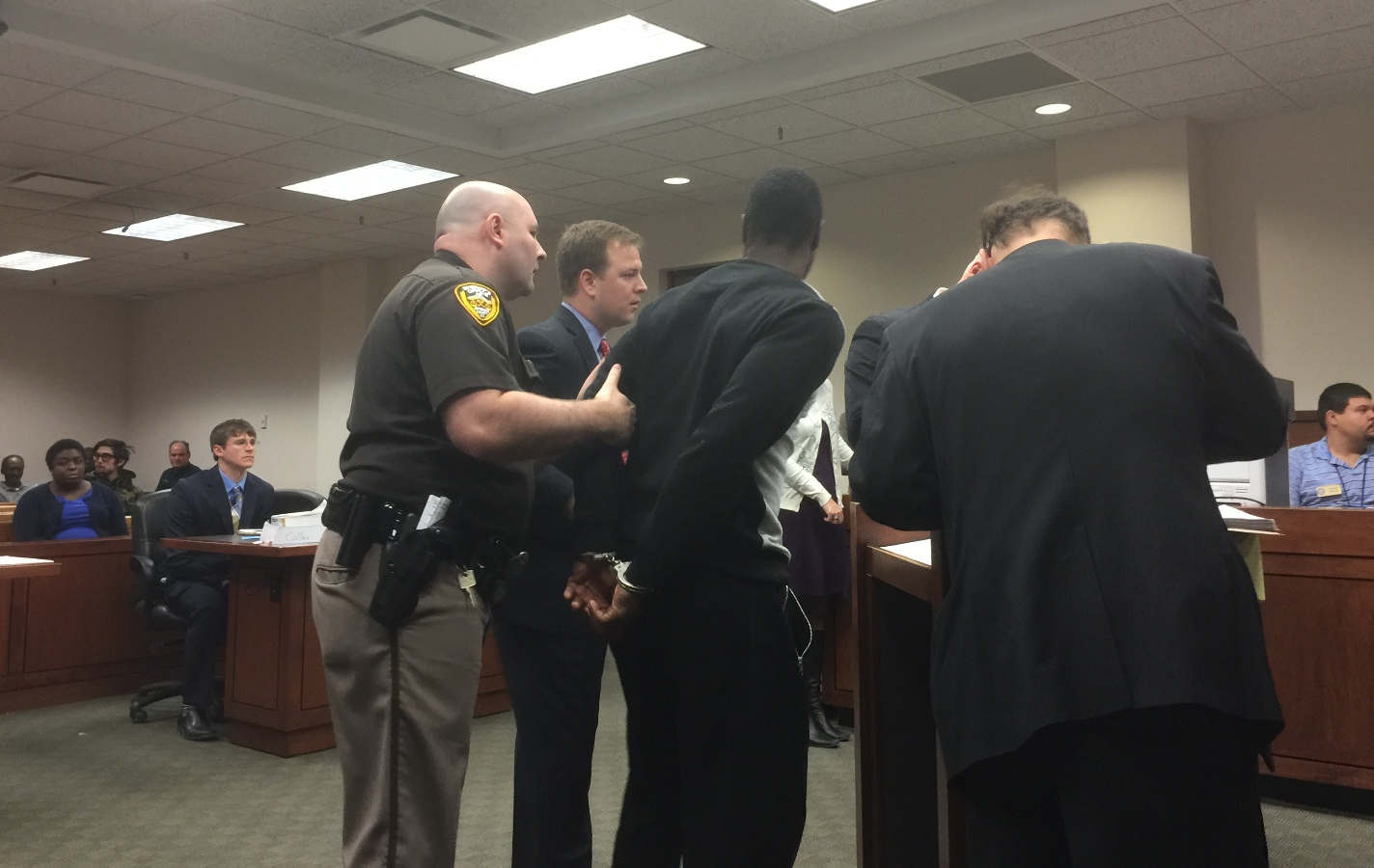 Chris Jones is handcuffed at Jefferson Circuit Court  for processing for multiple counts of rape and sodomy charges.