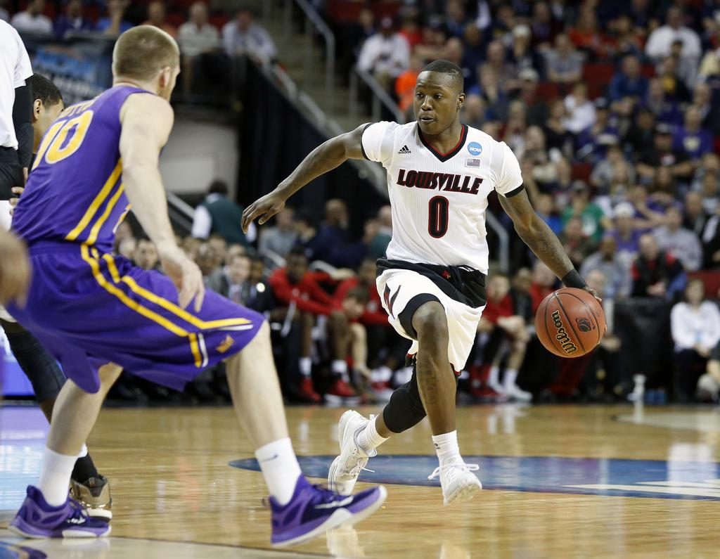 Louisville's Terry Rozier led all scorers with 25 points in UofL's victory over Northern Iowa to advance to the NCAA round of 16.  3/22/15 photo: CBS