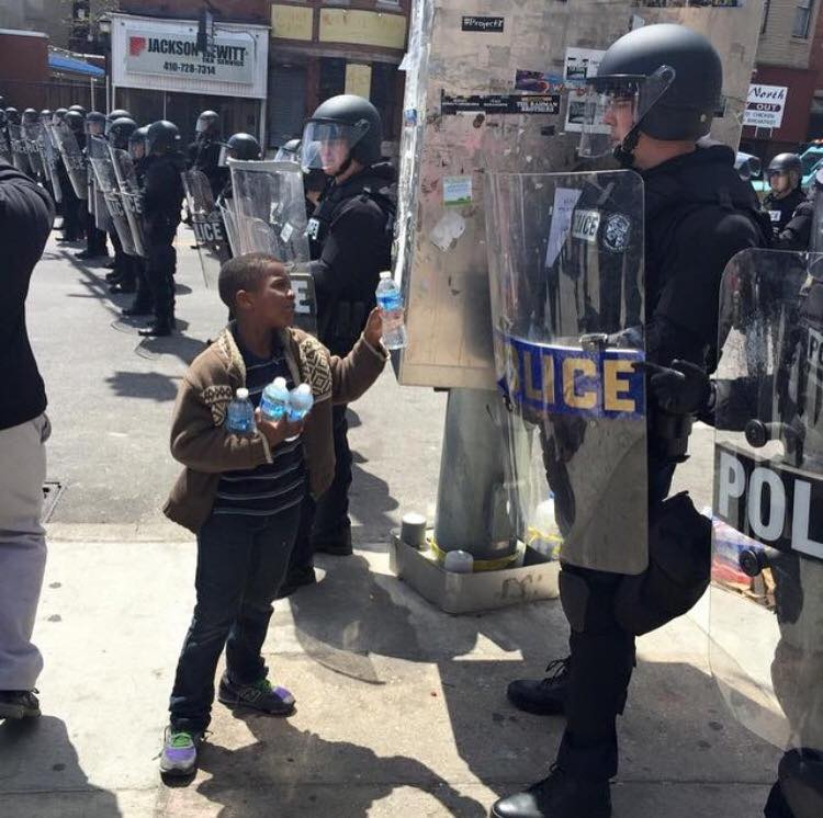 A child serving his community following the racially charged Baltimore riots of 2015