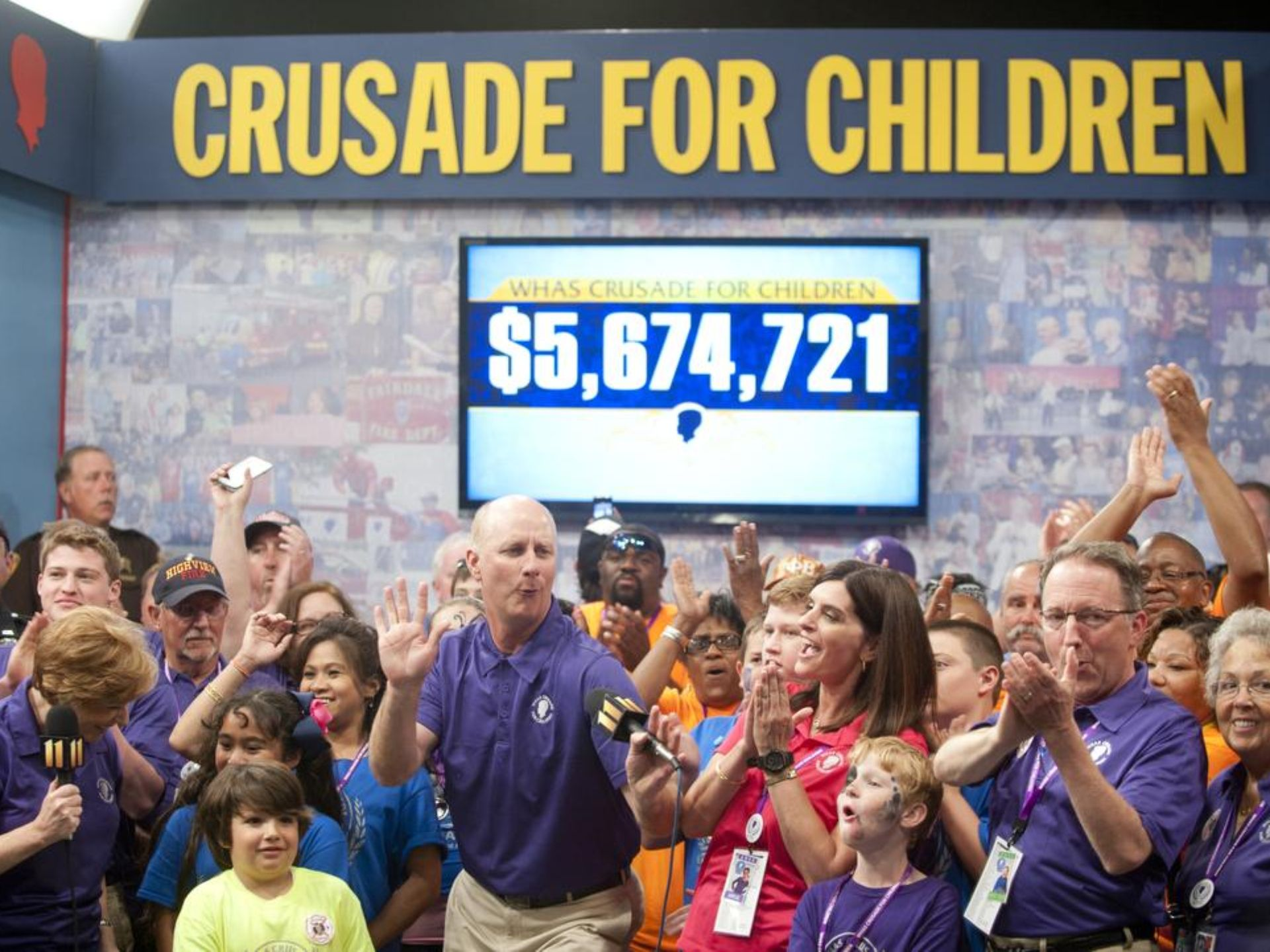 Volunteers celebrate the closing of the 2015 WHAS Crusade for Children (photo: David R. Lutman, The Courier-Journal)