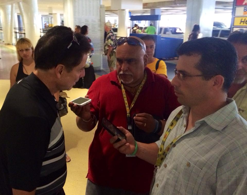 Rick Pitino greeted by local media at the San Juan airport terminal