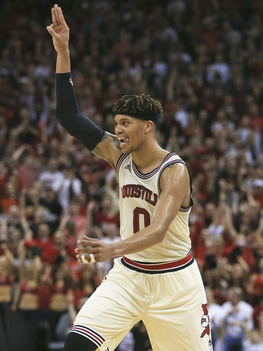 Damion Lee celebrates another 3 pointer as his Louisville Cardinals would go on to defeat Duke. (photo: Matt Stone, The Courier-Journal)