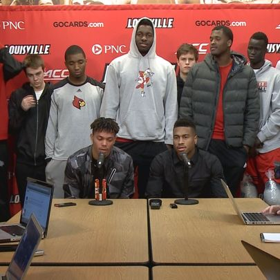 Damion Lee and Trey Lewis surrounded by teammates, February 5, 2016