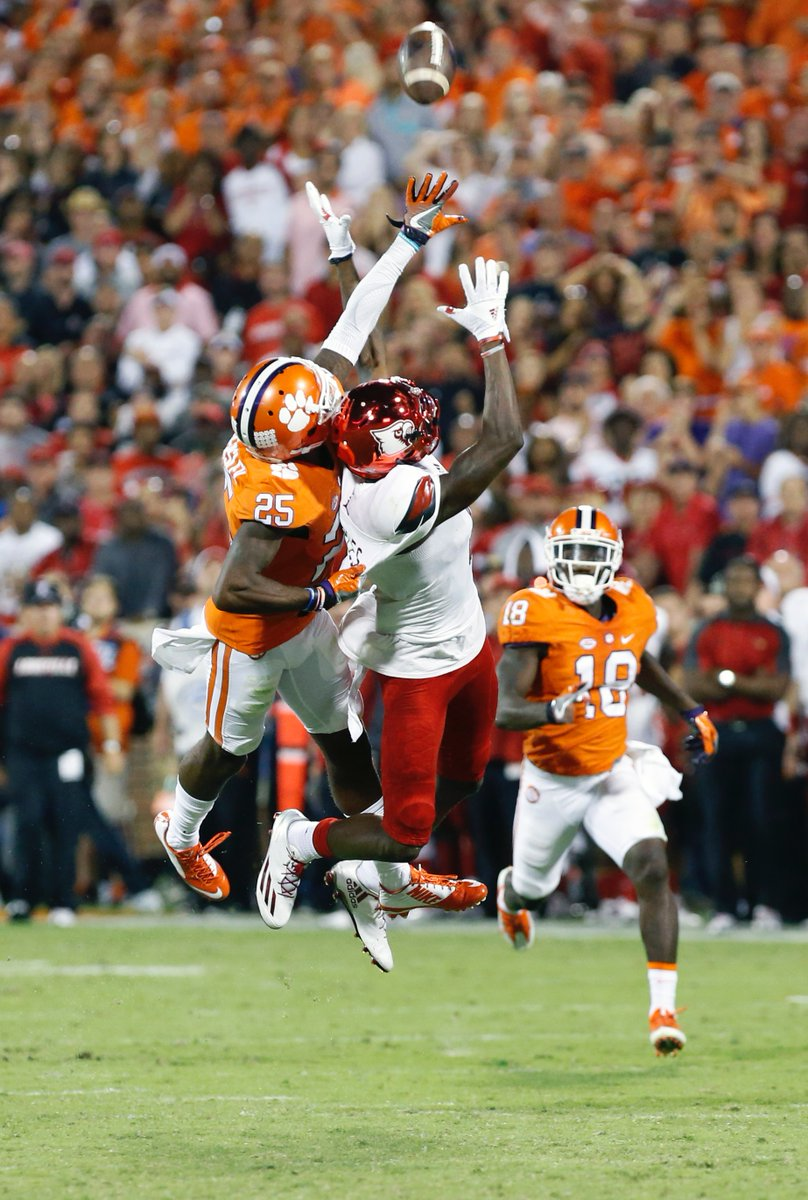 A Clemson defender pulls on  the jersey of Louisville Cardinal Jamari Staples.  No call.  Staples complains, gets 15-yard penalty.