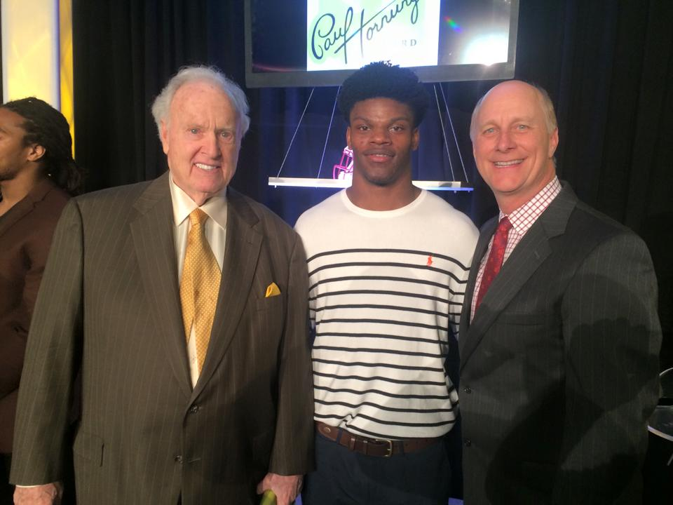 1956 Heisman Trophy winner Paul Hornung (Notre Dame) with Lamar Jackson in February 2016
