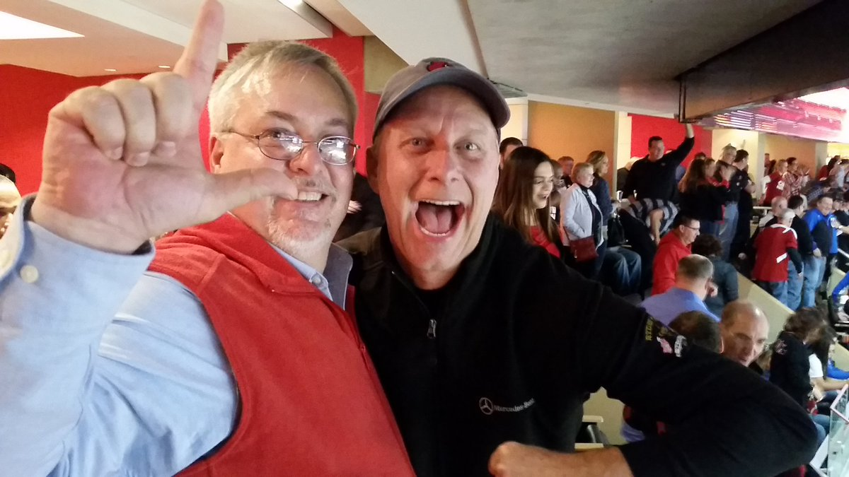 Sean Jarboe and Terry Meiners celebrate UofL's victory over UK in suite 71 at the Yum Center, December 21, 2016