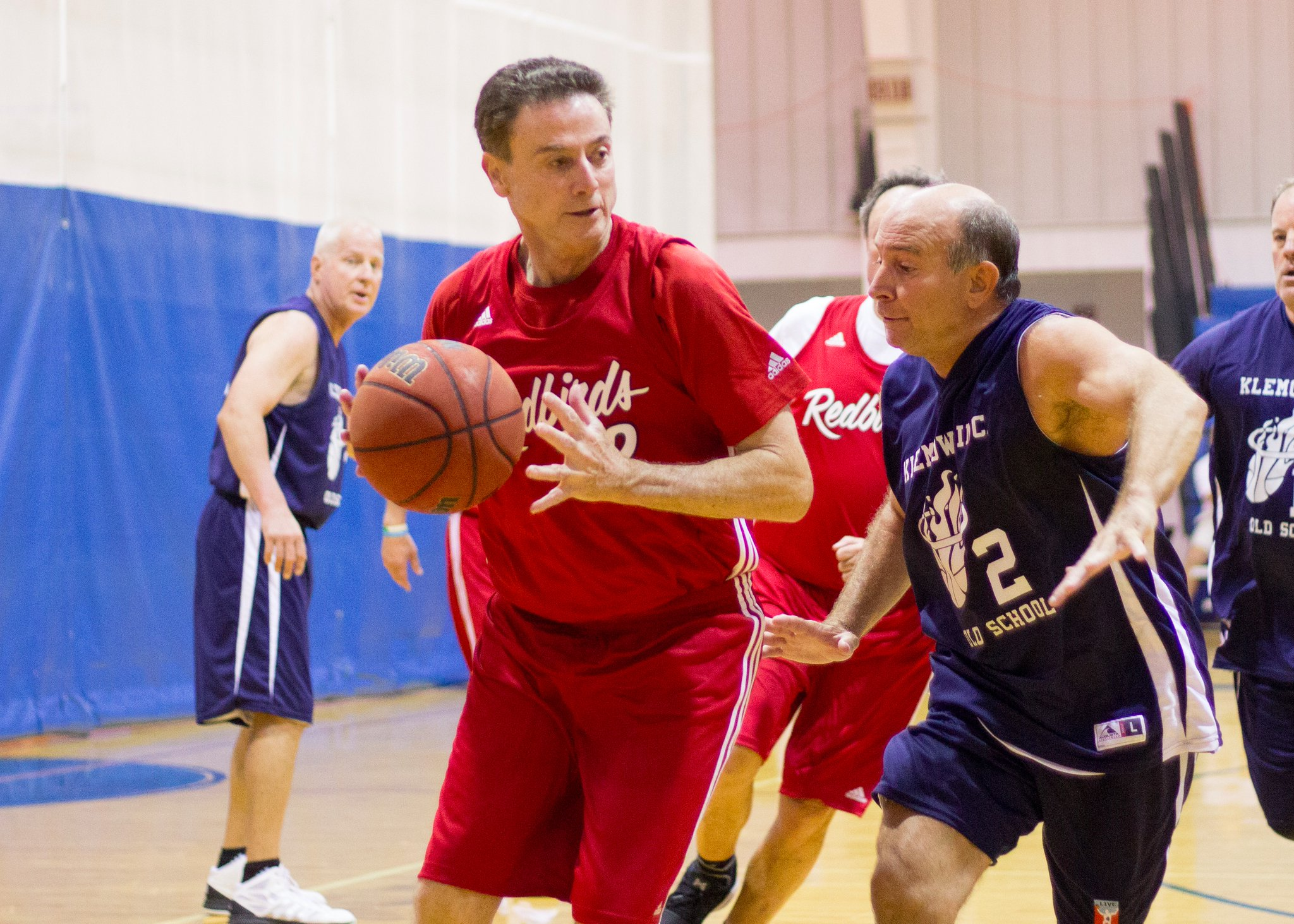 Rick Pitino guarded by Danny DeVito's doppleganger in the Masters Basketball Tournament in Coral Gables, Florida